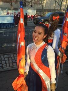 Undergraduate worker Sarah Tran in her color guard uniform